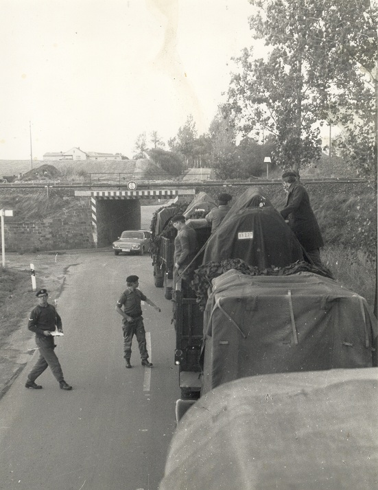 convoy at low bridge
